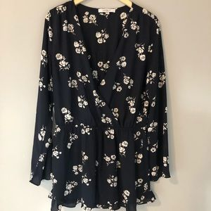 Pants - Navy and white floral romper with ruffle detail